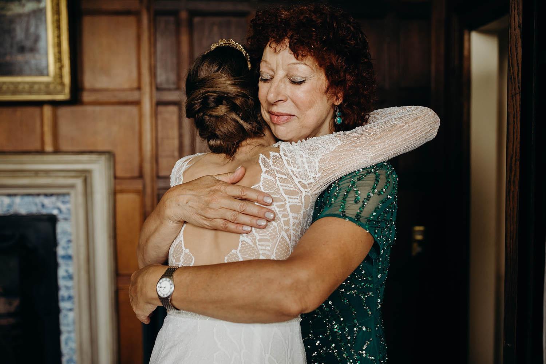 Brides mum hugging her