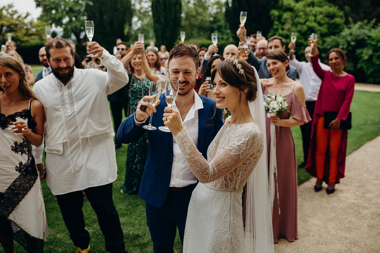 newly weds raising glass