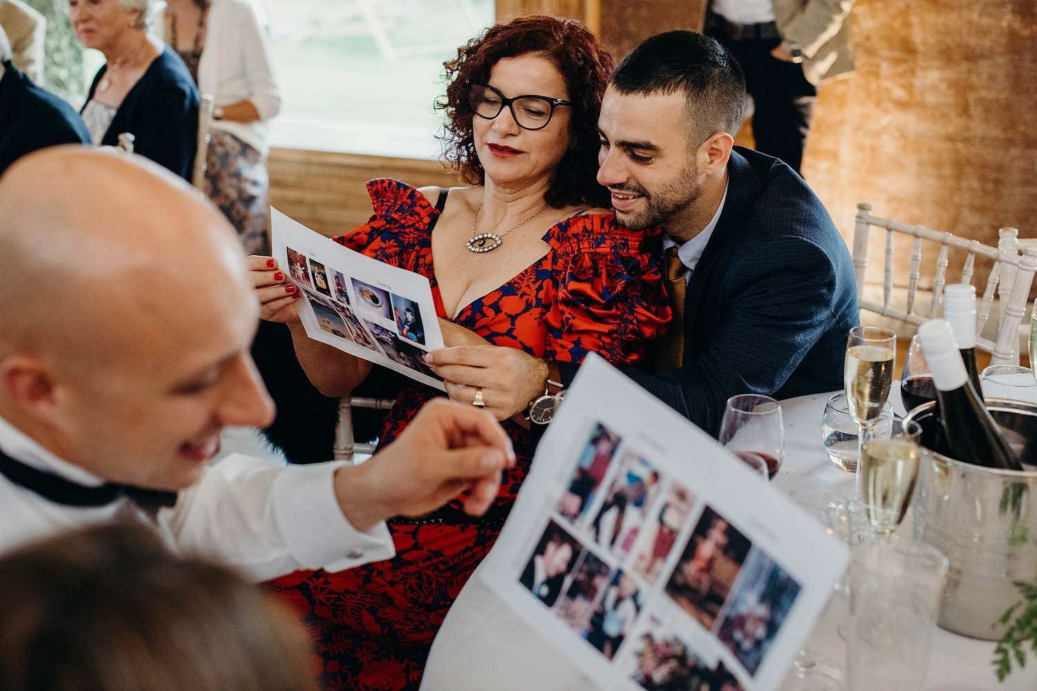 best man prints out pictures of groom