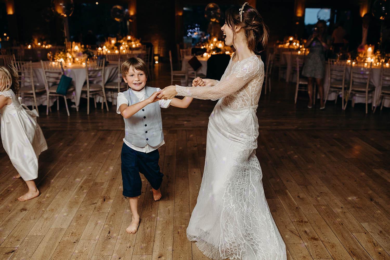 bride dancing with boy