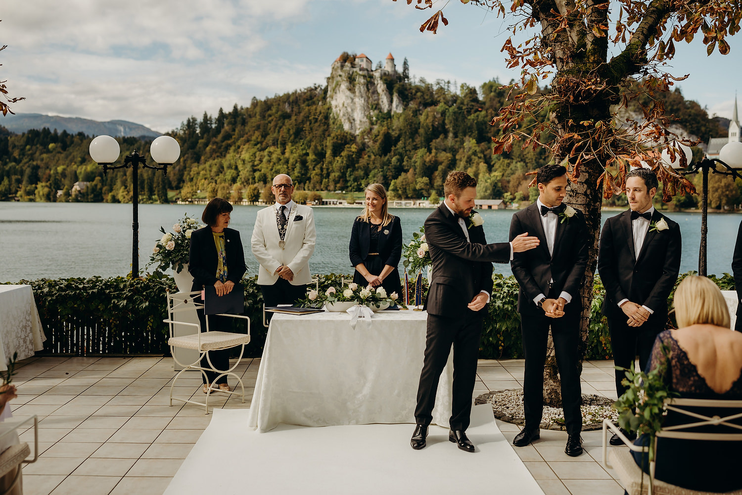 groom wipes dust from best mans suit