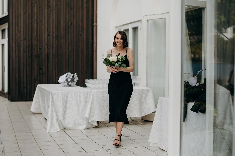 Bridesmaid walking to aisle
