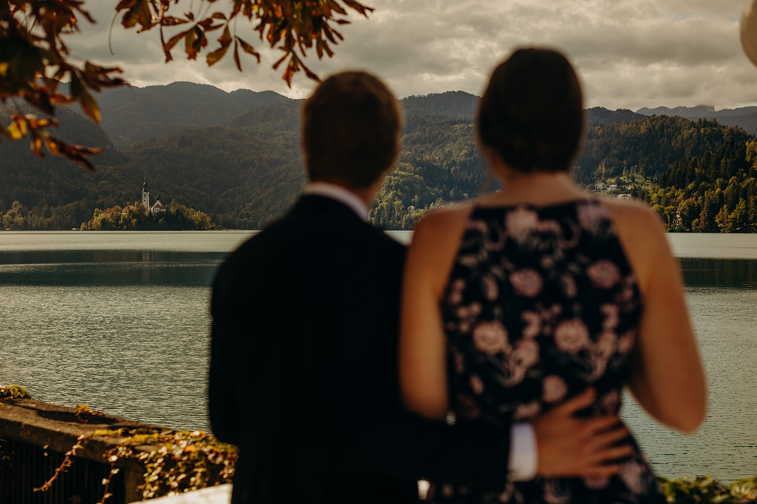 Couple admire view of Bled island at wedding
