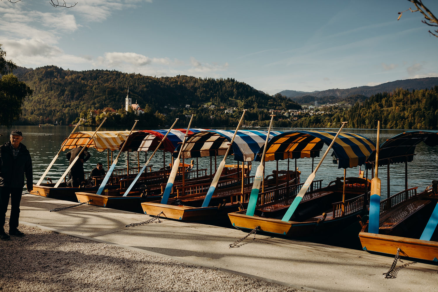Colourful Pletna boats on dock of Lake Bled