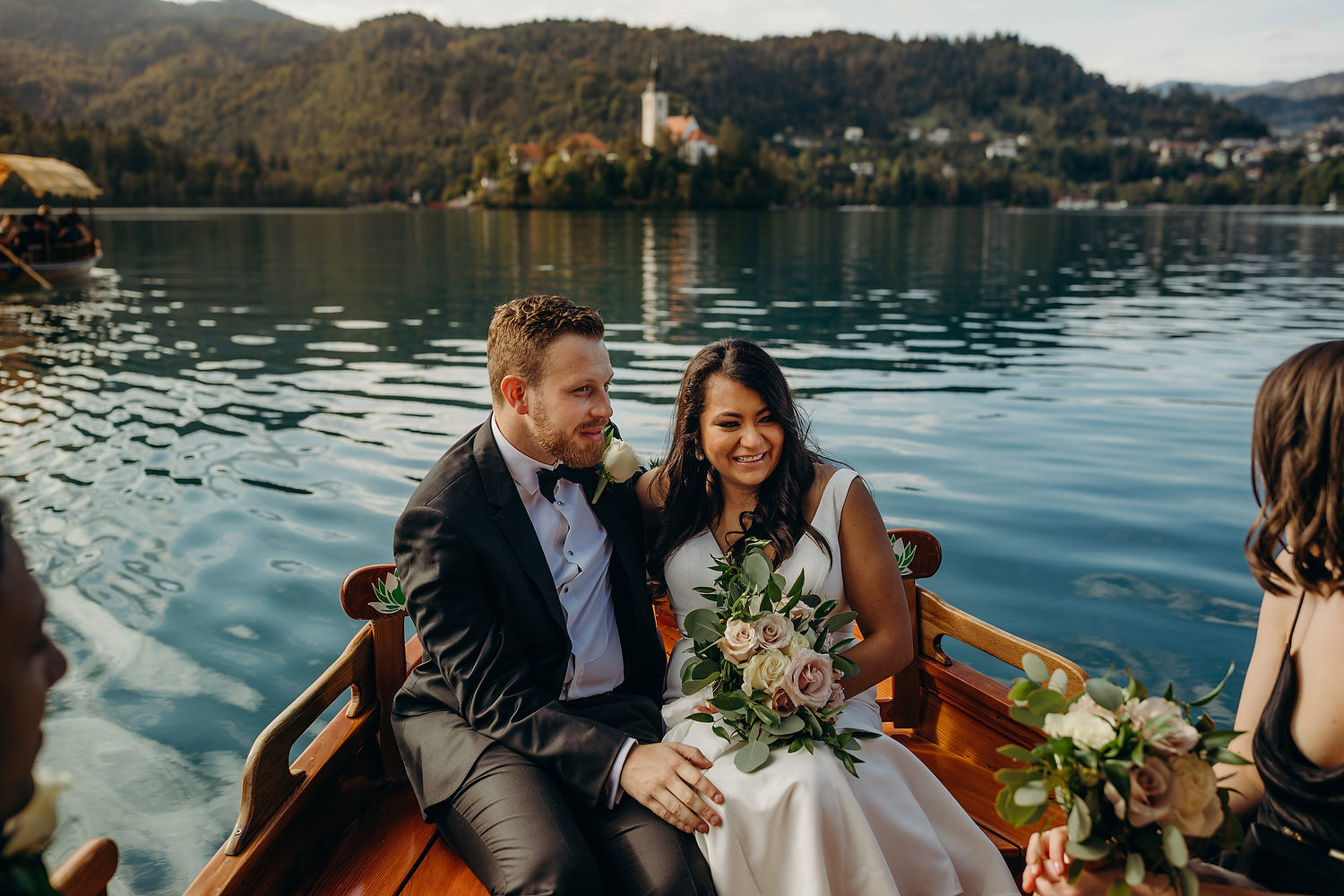 Bride and groom on boat on Lake Bled