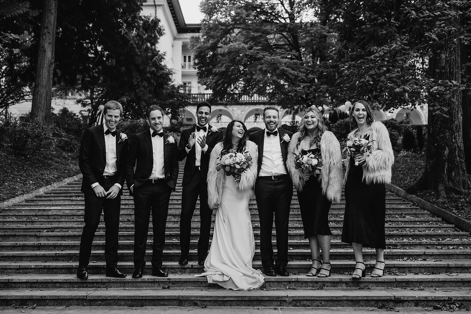 bridal party all laughing as they have a picture