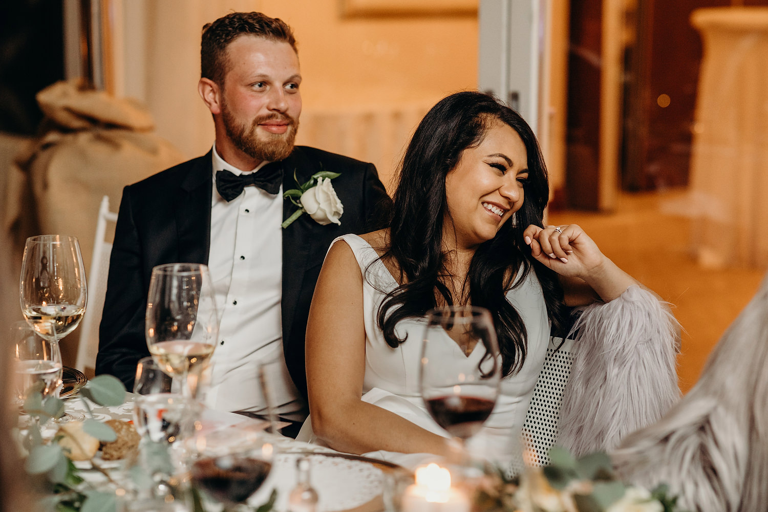 couple smiling during speeches