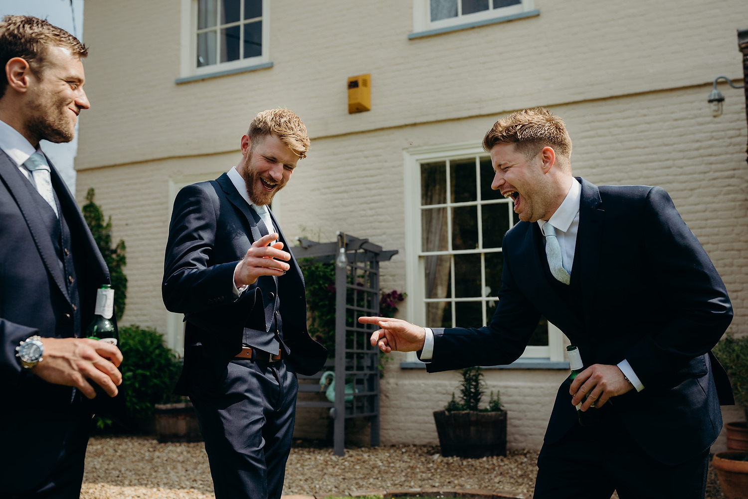 groom laughing with ushers