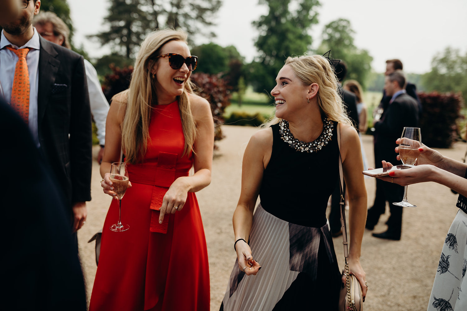guests laughing during drinks reception