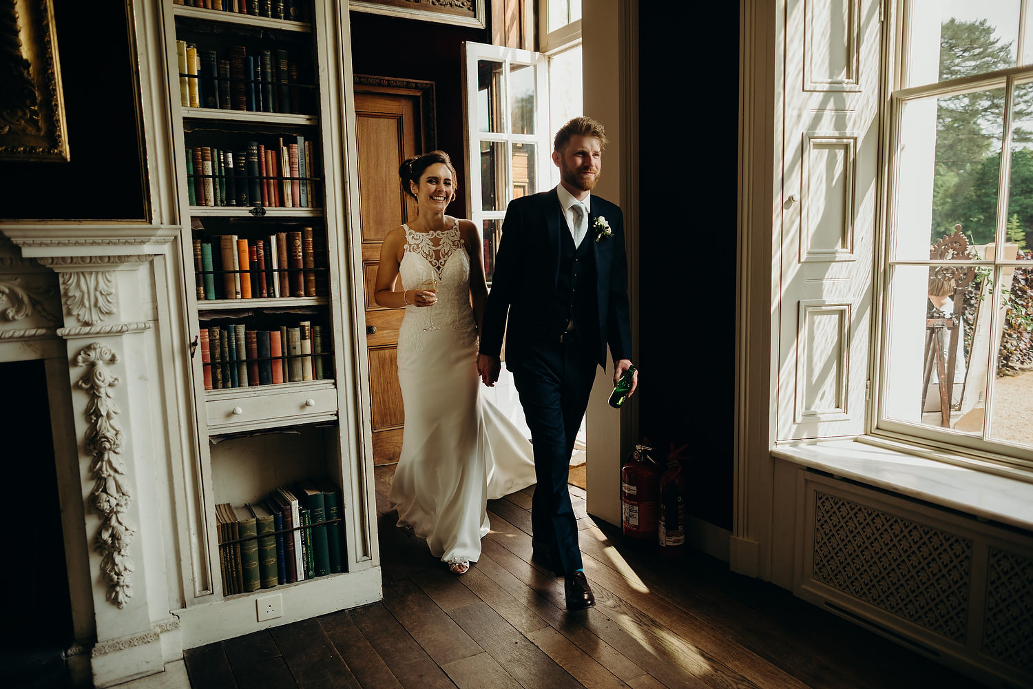 Bride and groom walk into the old library room