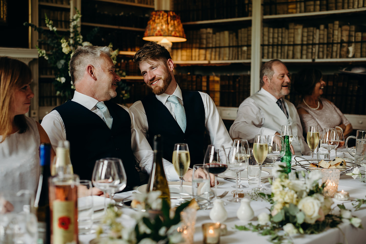 groom smiling at father