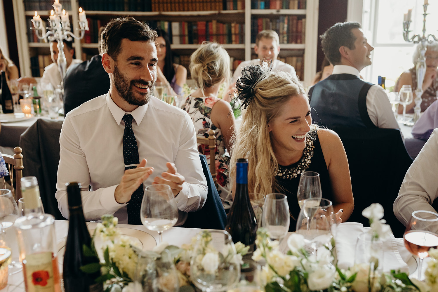guests laughing at wedding table