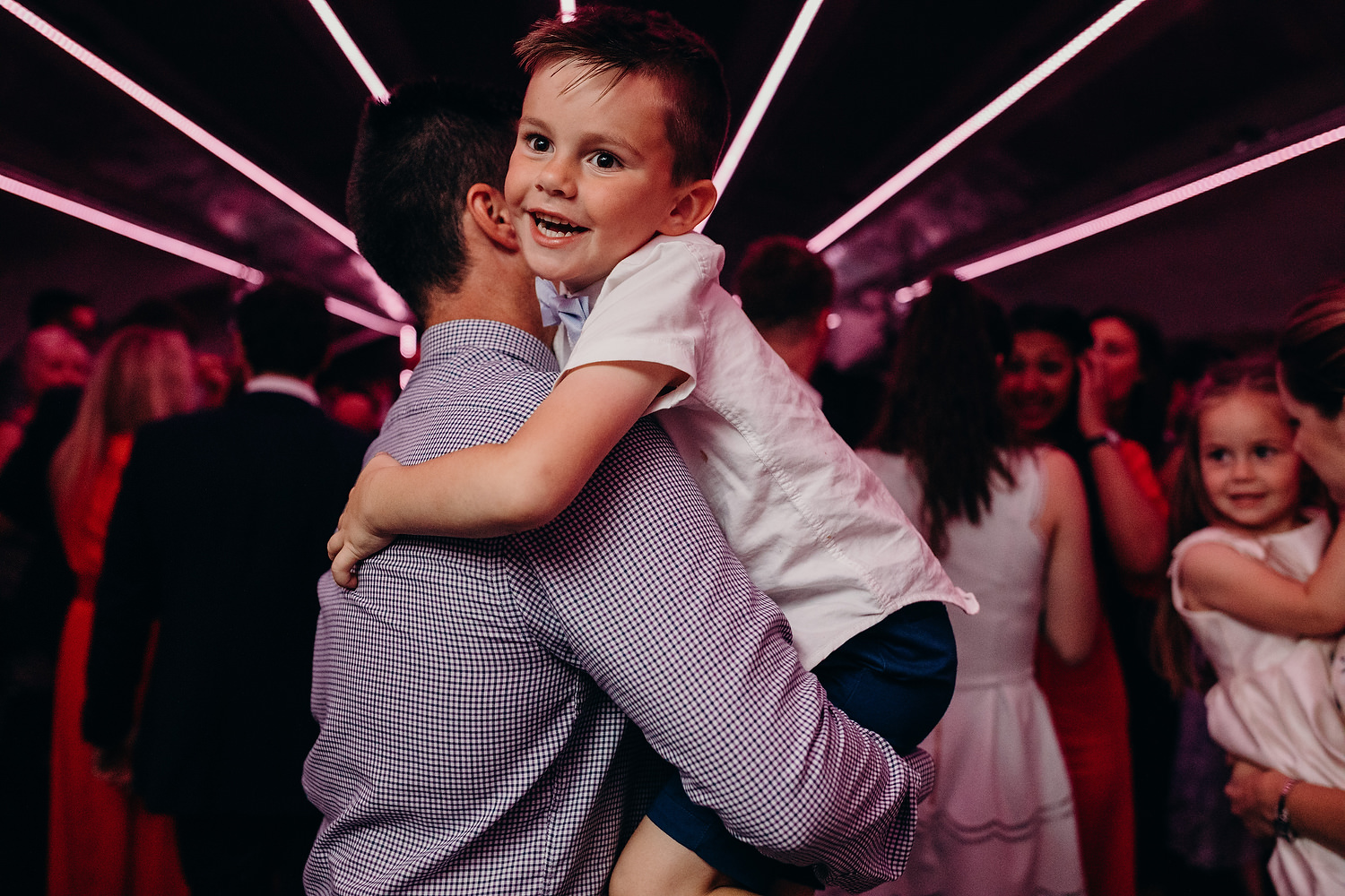 boy dancing with father