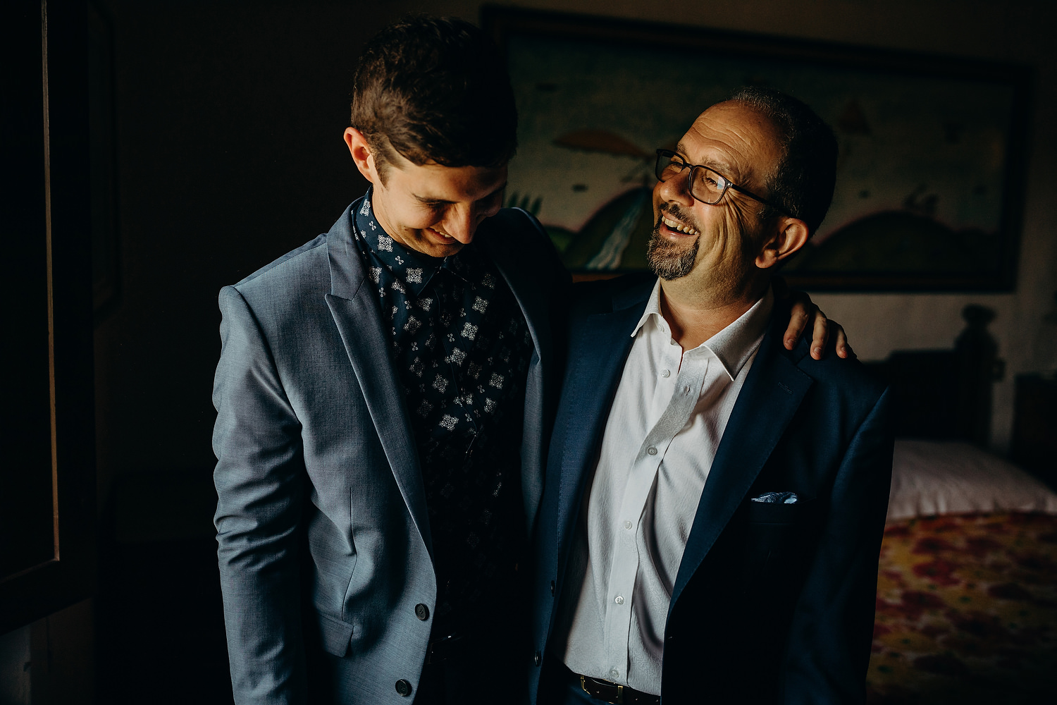 groom and father sharing a moment