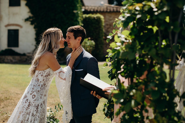 bride walks down aisle and kisses groom