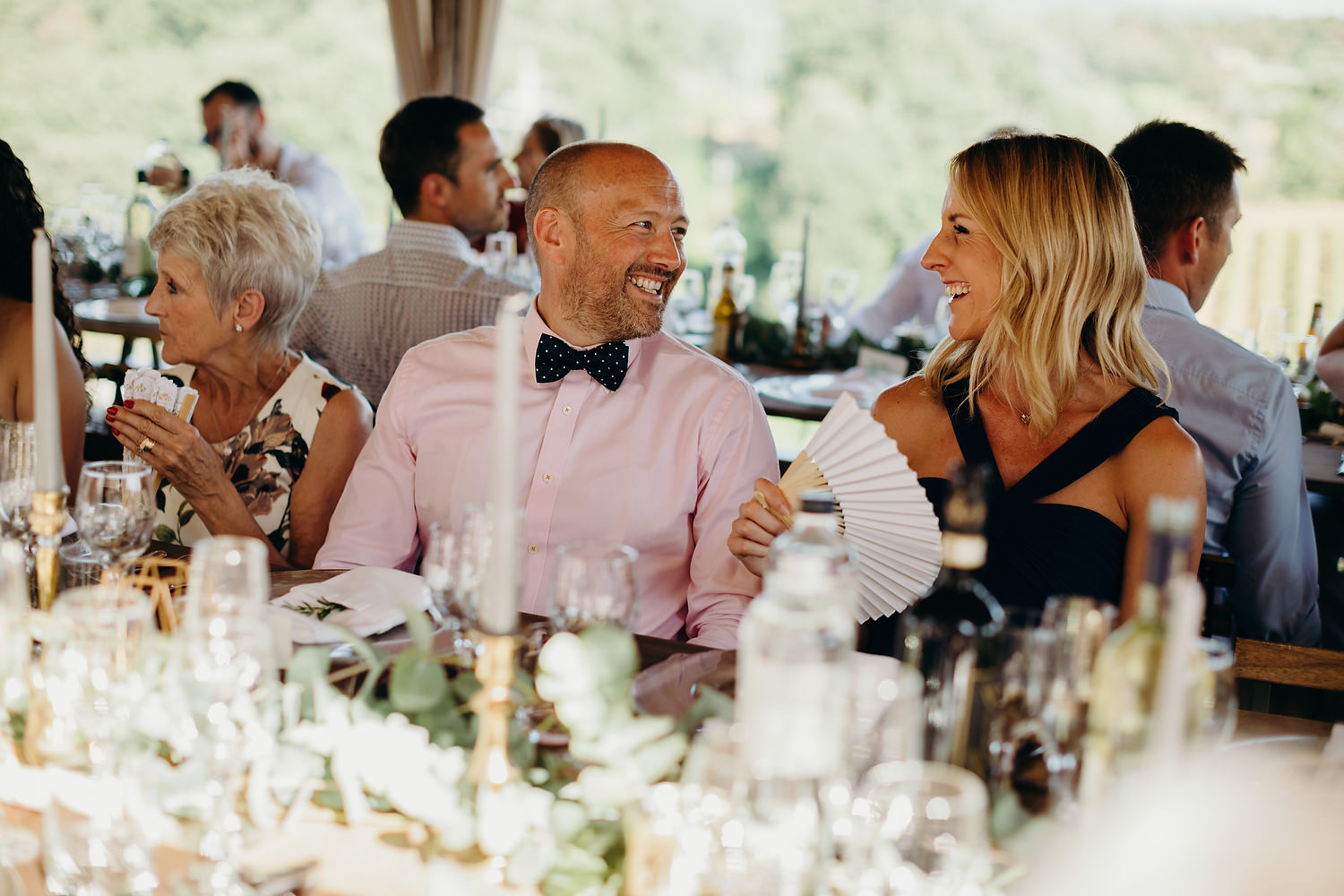 guests laughing before the wedding feast