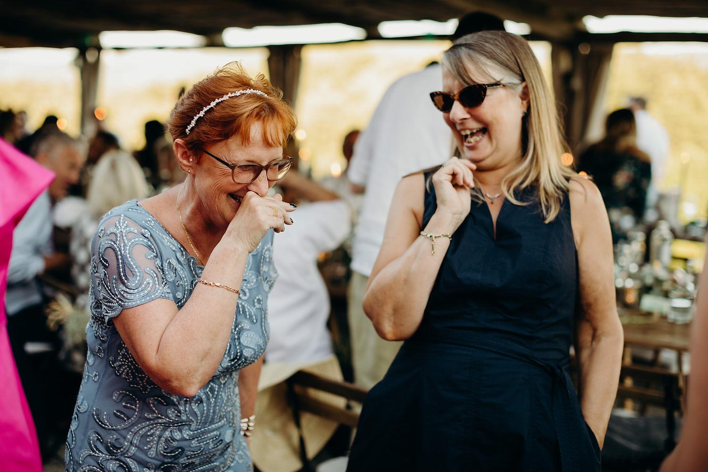 ladies laughing at wedding