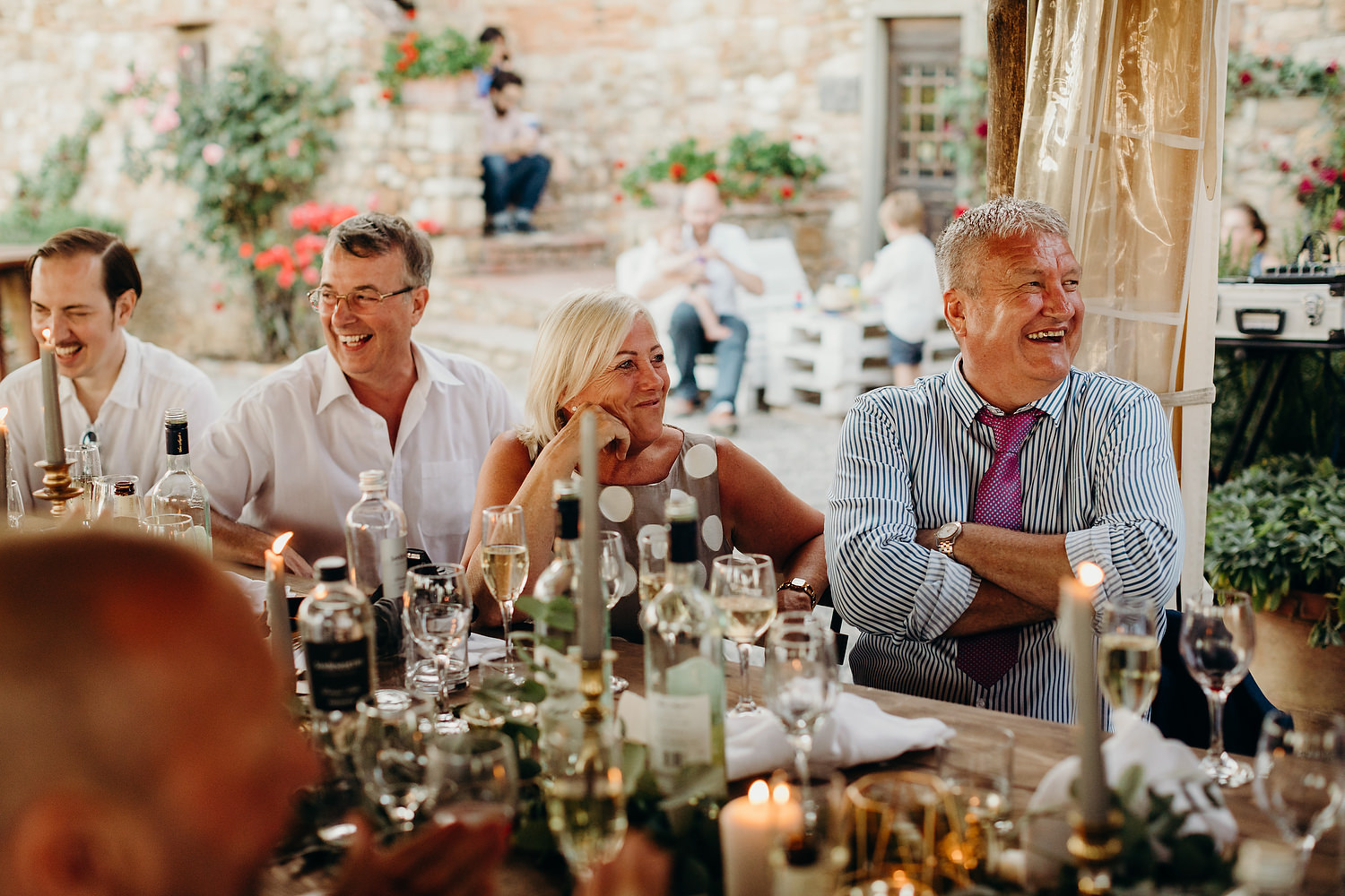 guests laugh at outdoor wedding