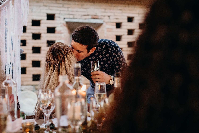 groom kisses bride during speeches