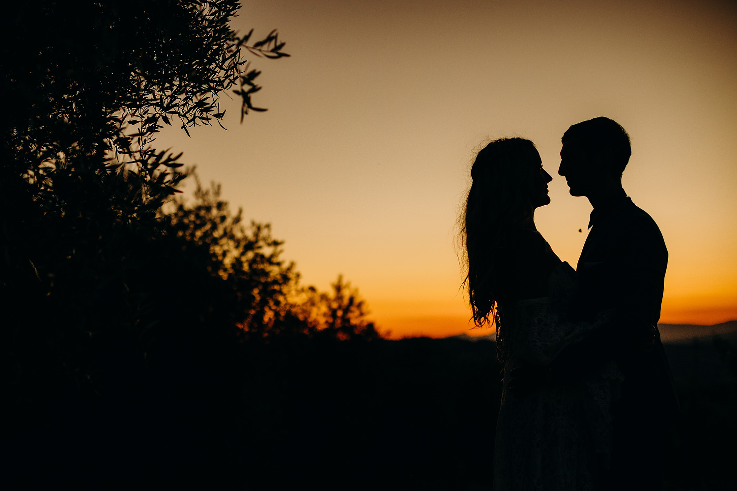 sunset silhouette of couple