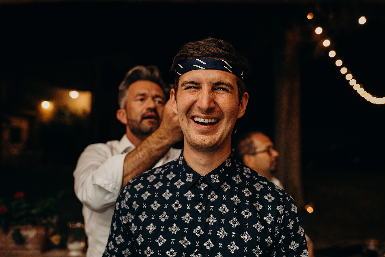 groom putting tie around head