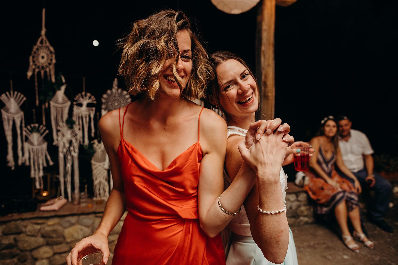 two woman dancing at wedding